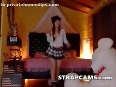Sweet looking teen teasing on webcam