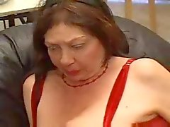 An old granny fucked by a young lesbian