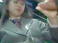 Schoolgirl gives handjob on a bus