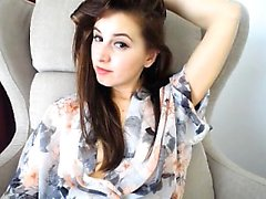 Alluring brunette teen exposes her sweet body and caresses