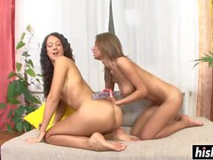 Two gorgeous girls share a dildo