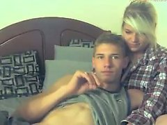 Cute couple are having fun on their webcam putting on a sex