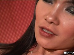 Busty Thai chick enjoys a huge dick in her cunt
