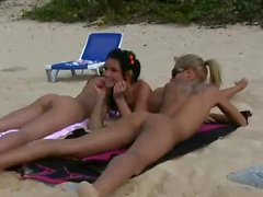 Naked teens fool around on public beach