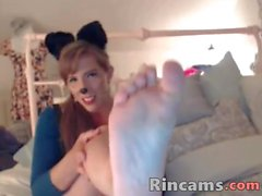 Kitty with cock footjob