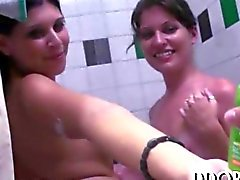 Arousing college teens shower and toy together