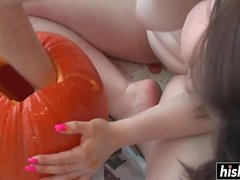 Awesome chick plays with a pumpkin