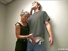 Horny cougar gives well hung guy a handjob