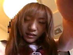 Pretty Asian schoolgirl sensually reveals the hot contours