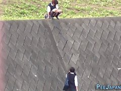 Teen asians pee outdoors