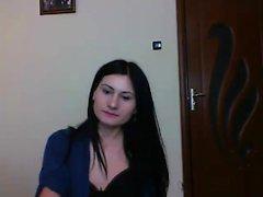 Skinny brunette sets up her live webcam and shows off her b
