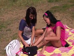 Nasty lesbians please each other outdoors