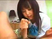 Sluty asian cheerleader in uniform giving blowjob in kitchen