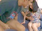 Tenacious dudes pound a thin teen in an interracial threesome