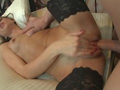 Brunette honey in black stockings takes hard cock doggy style