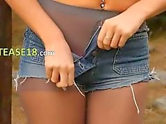 Blonde woman in pantyhose teasing forest