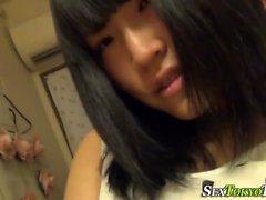 Japanese ho rubs her clit