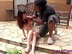 Tiny Japanese teen sucking black cock outdoors
