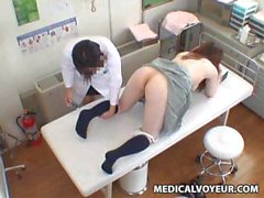 Japanese girl in short skirt has tits examined