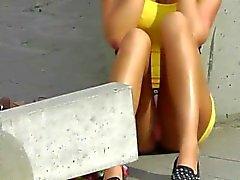Teen girl shows off her panties for money