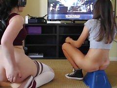Teen girls play videogames