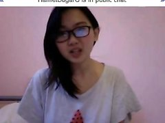 Young and pretty Asian nerd offers a sexy sneak peek of her