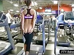 Brunette sporty babe works her big tits in public