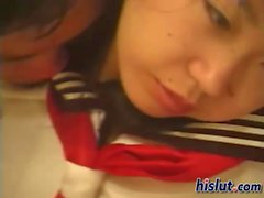 Asian schoolgirl blows on a throbbing manhood