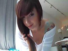 Hot Tattoo girl riding a dildo