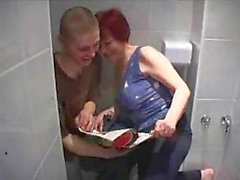 Mature redhead takes young cock in bathroom