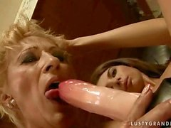 Teen fucks granny with a strapon dildo
