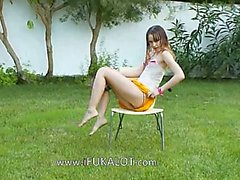 Ivana teen getting wet on the garden