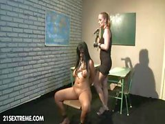 Busty brunette is in the hands of her mistress and gets punished