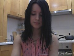 Splendid teen with glasses chatting in the kitchen