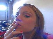 Addison Crush smokes cigarette in garage