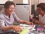Mature Asian gal eats with a younger man then sucks his dic