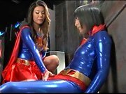 Asian teen wearing a latex dress and playing