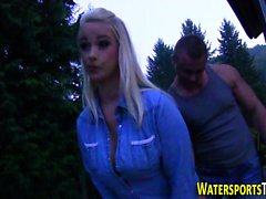 Busty whore pissed on