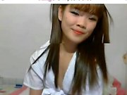 Stunning Asian girl with pigtails exposes her curves for he