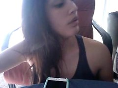 Stunning young bombshell poses and plays with her phone for