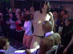 MC gets chicks on stage to put on a 'hollow o ring' around their waist, dancing