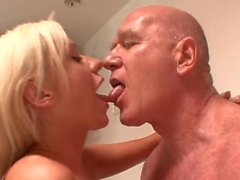 He was taking a shower when she felt the need to blow his cock