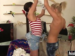 Two lesbian babes use a sex toy