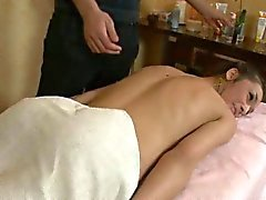 Dude is massaging playgirl with oil