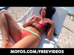 Sun tanning bikini babe has her wet pussy penetrated