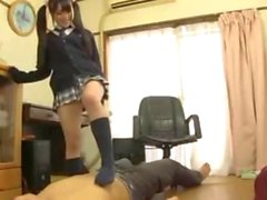 Fun Japan schoolgirl teen sucking on a rod