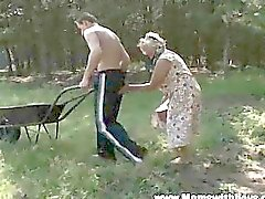Mature Lady Lures Young boy Into The Woods