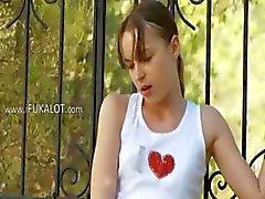 slim Ivana teen playing in backyard