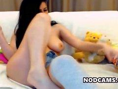 Kinky teen spreads her legs
