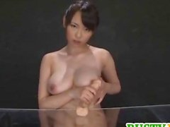 Akane plays with dildo on cans